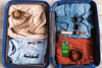 Open luggage full of clothes