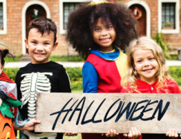 Kids handing Halloween sign