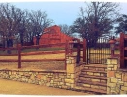 Stone Retaining Wall with Split-Rail Cedar Fence