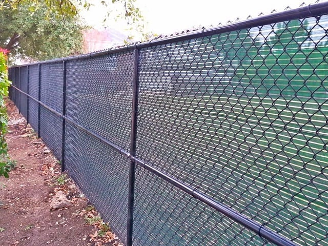 Black Chain Link Fence with Green Windscreen