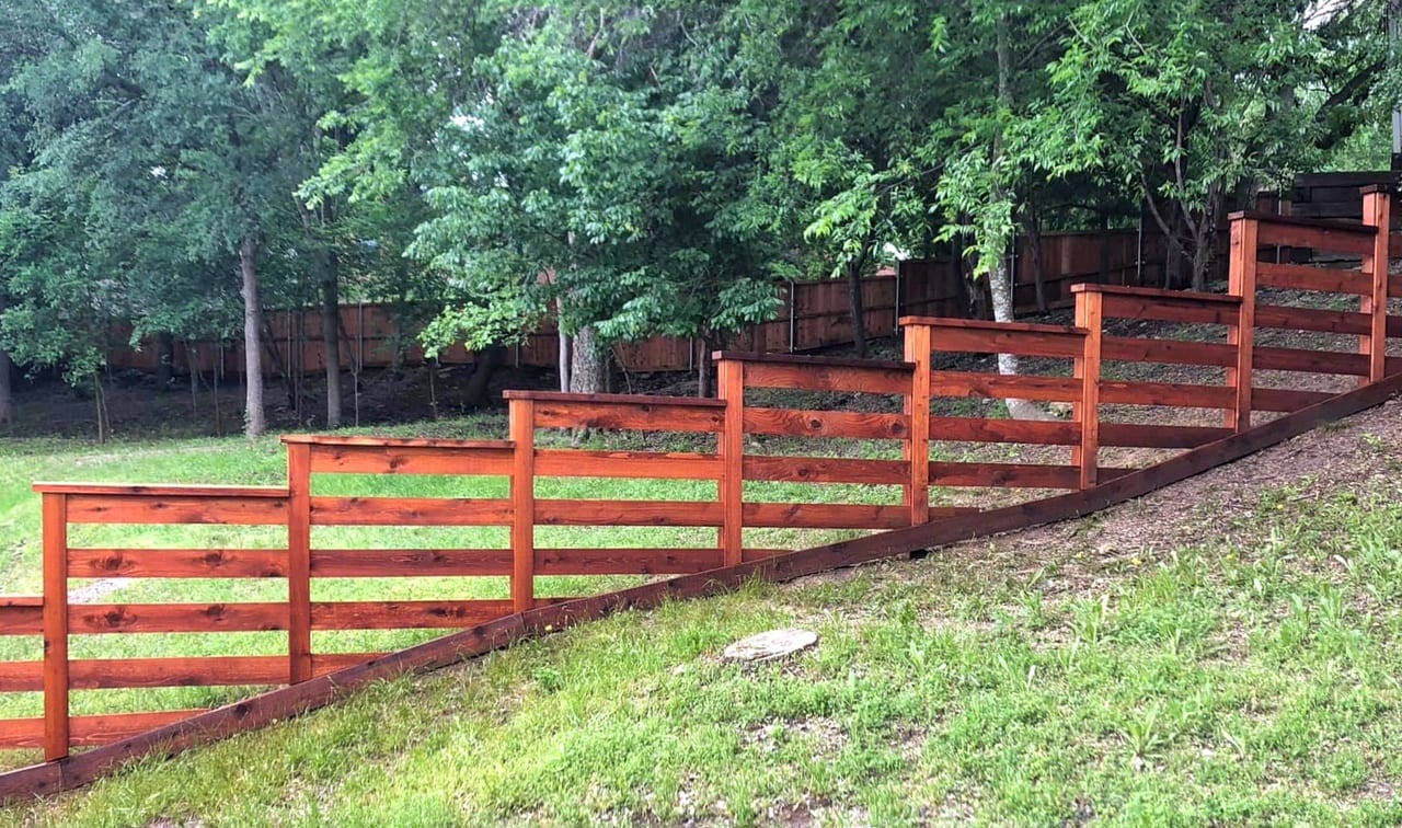 sloped cedar stained fence
