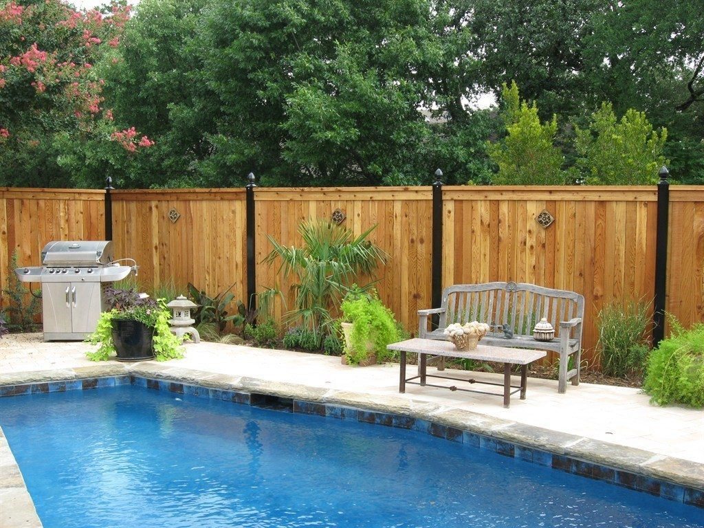 Wood Fence installed by Buzz Custom Fence in a homeowner's backyard